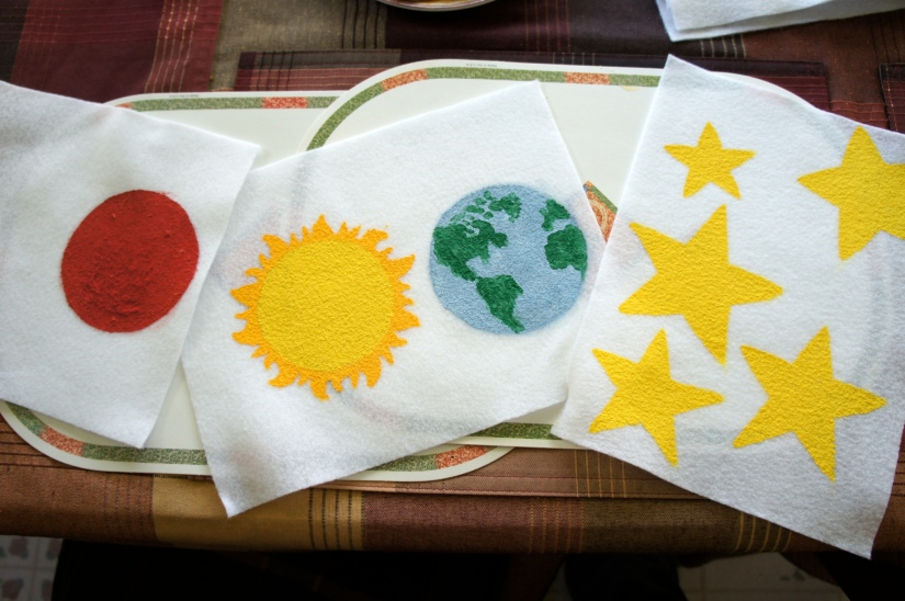 Painting planets on felt